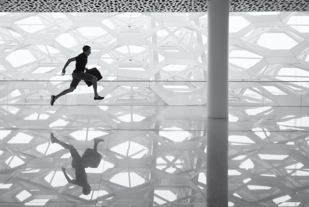 man running with brief case