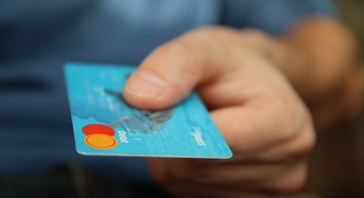 man-holding-a-credit-card