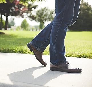 man walking in the sidewalk